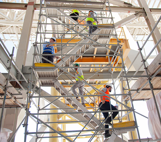 Construction workers on scaffolding stairs