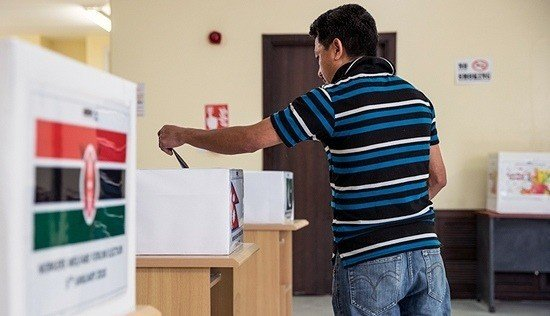 A worker casting his vote.