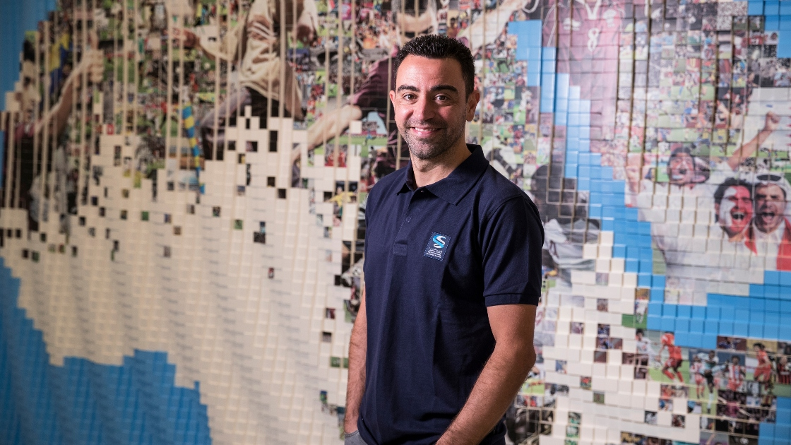 Xavi in front of Qatar 2022 mural
