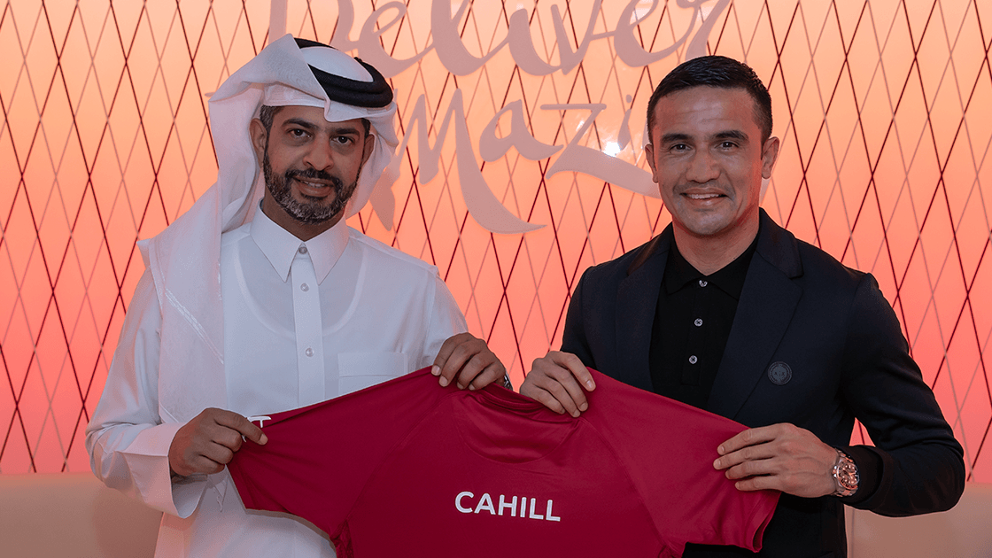 Cahill with CEO of the FIFA World Cup Qatar 2022 LLC, Nasser Al Khater