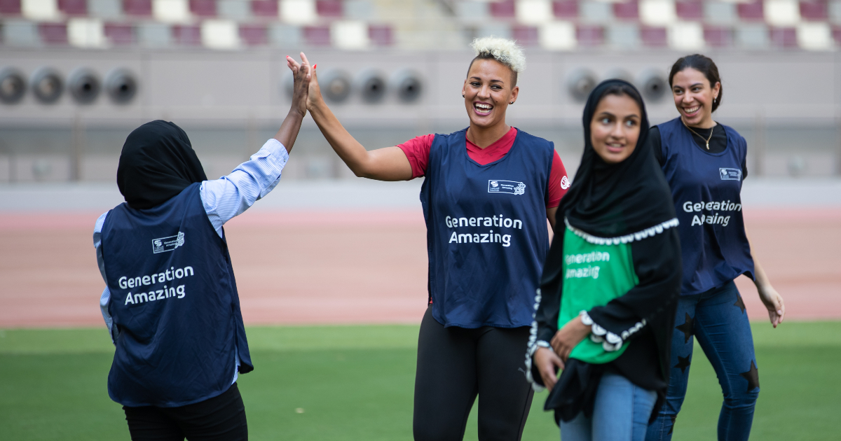 Lianne Sanderson with youth from Generation Amazing at Khalifa Stadium in Doha.