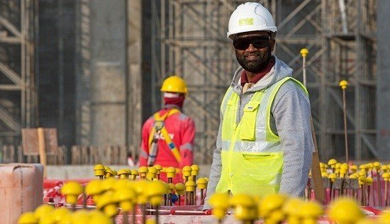 Worker smiling on a construction site