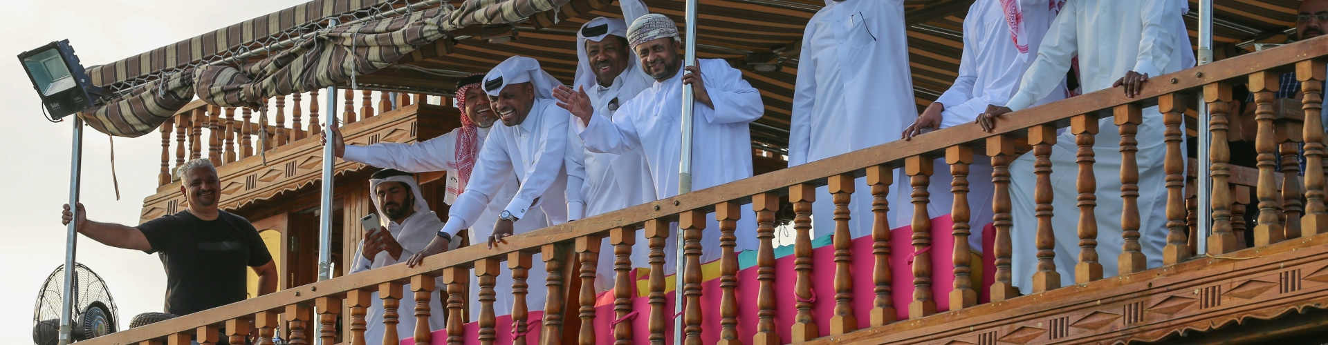 Ibrahim Khalfan on a wooden balcony with SC local ambassadors