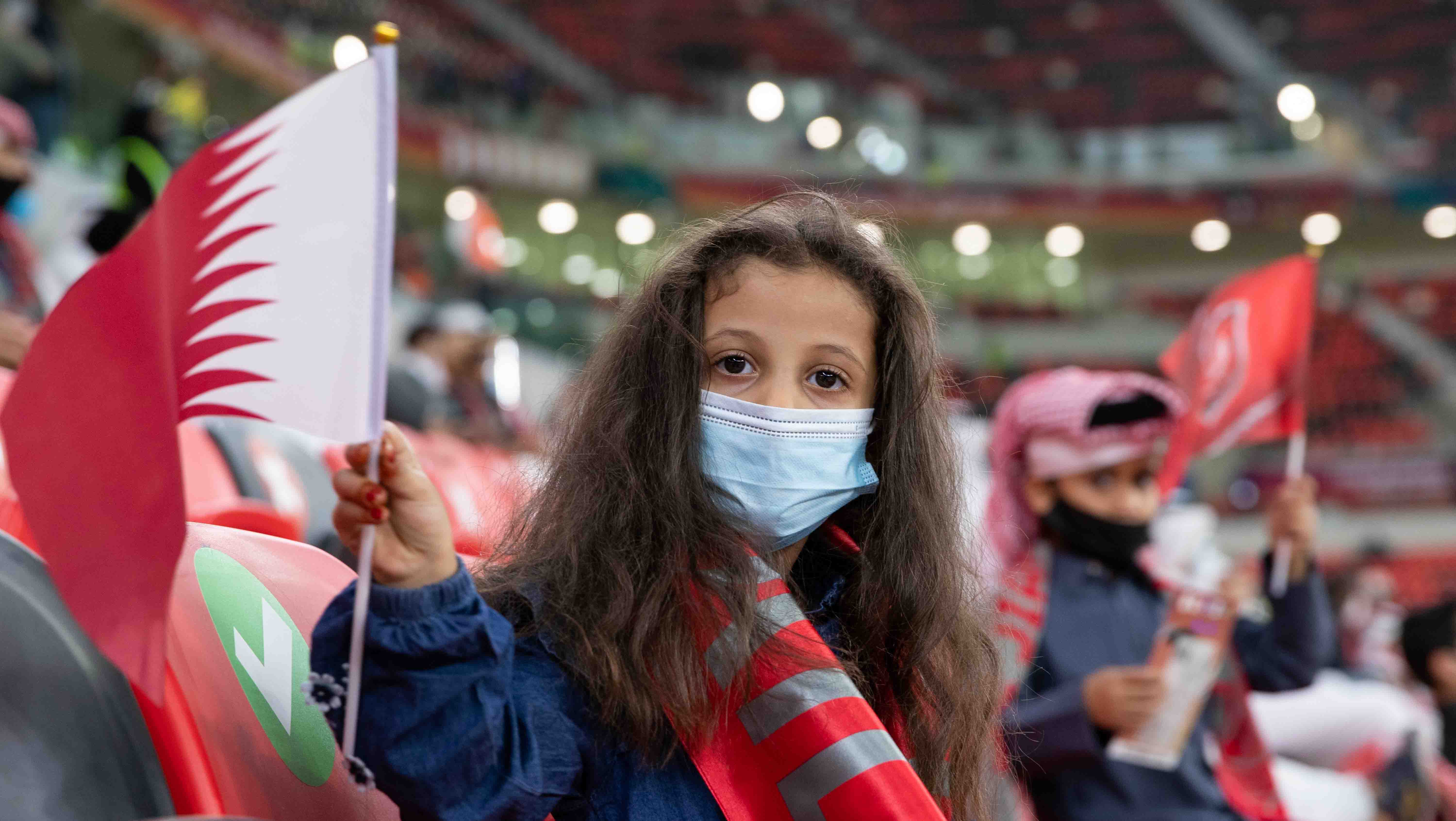 Girl holding Qatar flag