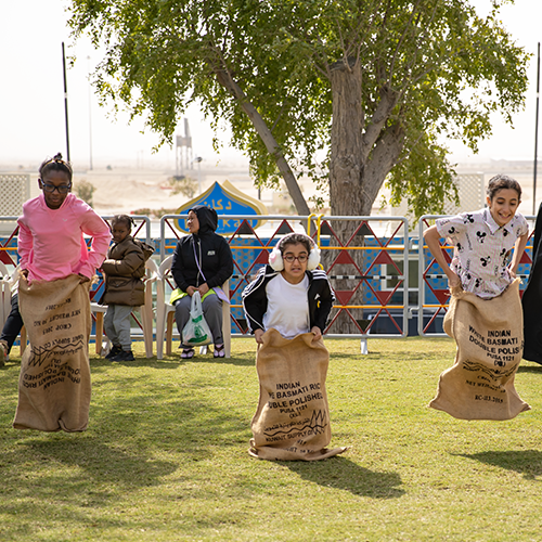 Children competing in a sack race